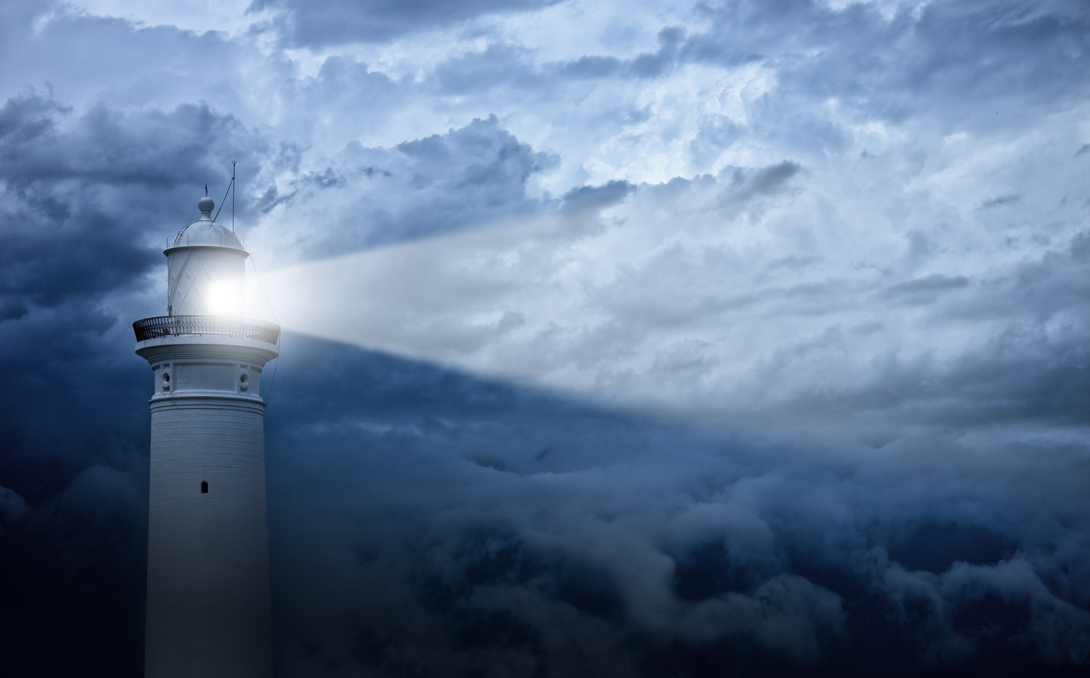 Lighthouse-and-bad-weather-in-background-655548518_2199x1367